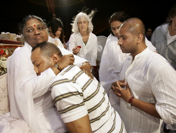 Amma, The Hugging Saint transfers love like a mother to child